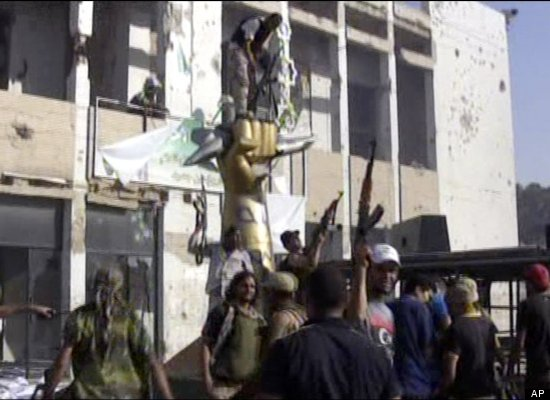 Rebel fighters react after entering into Muammar Gaddafi's compound in Tripoli.