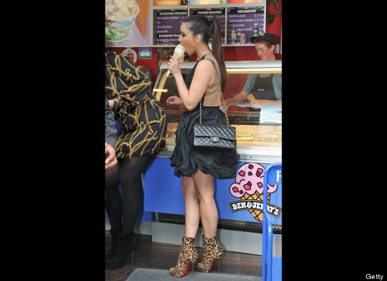 Kim Kardashian proves that no obstacle -- not even painfully high leopard stilletos -- can keep her away from a Ben & Jerry's