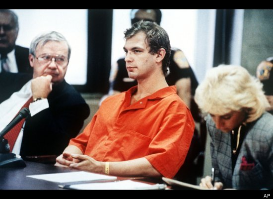 Notorious cannibal Jeffrey Dahmer sits with his defense team during his 1991 trial. Dahmer went on a killing spree in the 198