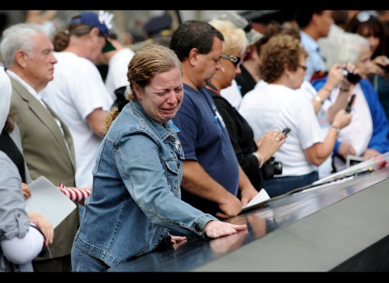 A woman cries while looking at the names inscribed at the North Pool of the 9/11 Memorial during 10th anniversary ceremony o