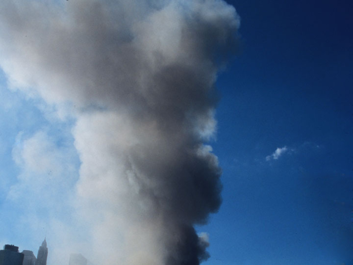 A ghastly, toxic plume of smoke and ash rises into the sky following the total collapse of the North and South Towers of New