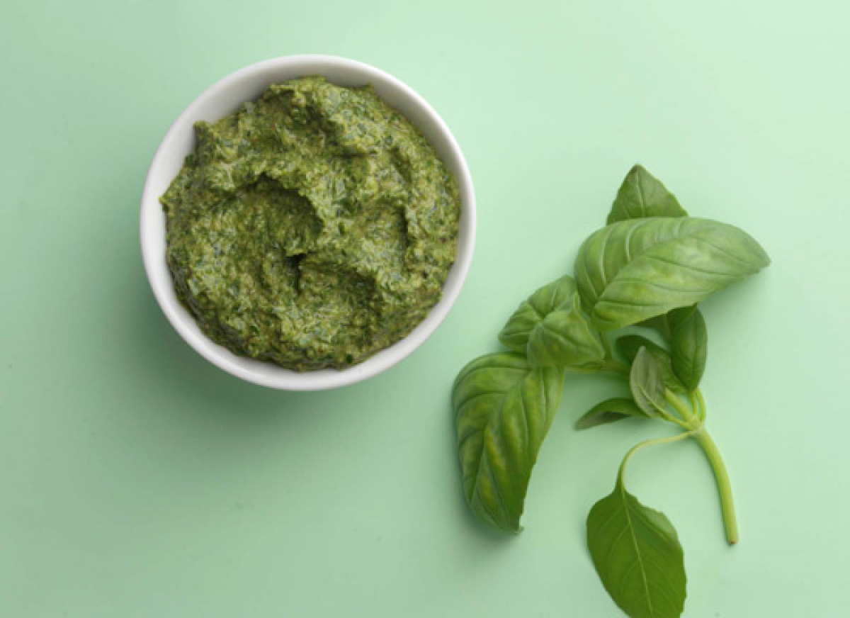 Any basic pesto has five ingredients: basil, Parmesan cheese, nuts, garlic and oil. This recipe uses walnuts instead of the m