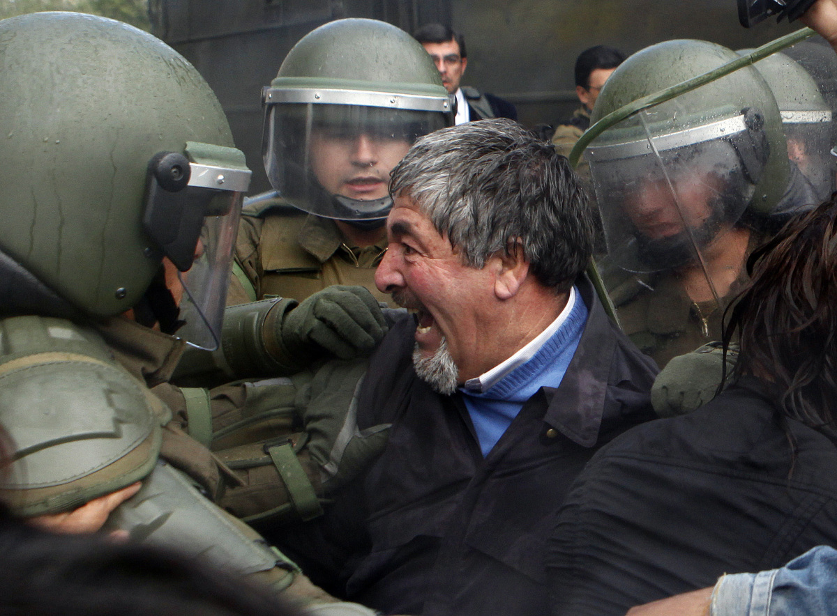 A demonstrator argues with riot police during student protest in Santiago, Chile, Thursday Oct. 6, 2011. Chilean police sever