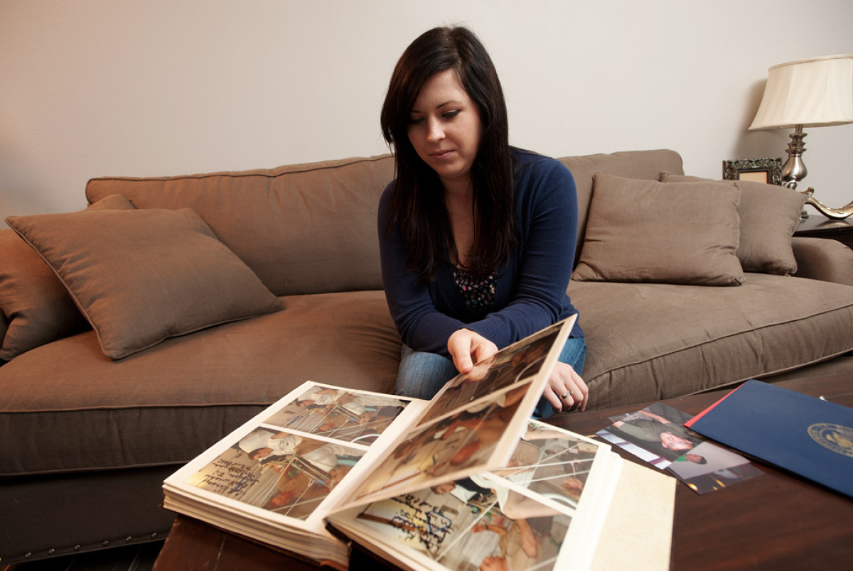 Karie Fugett looks at a scrapbook of her and her late husband Jimmy Cleveland Kinsey II Monday, October 3, 2011 in her Orange