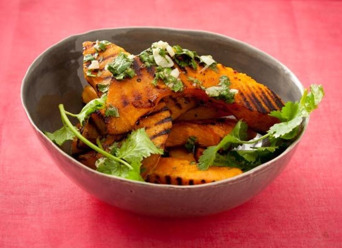 Grilling acorn squash brings out its sweet caramelized flavors. For a lively serving sauce, try a cilantro mojo, which is mad