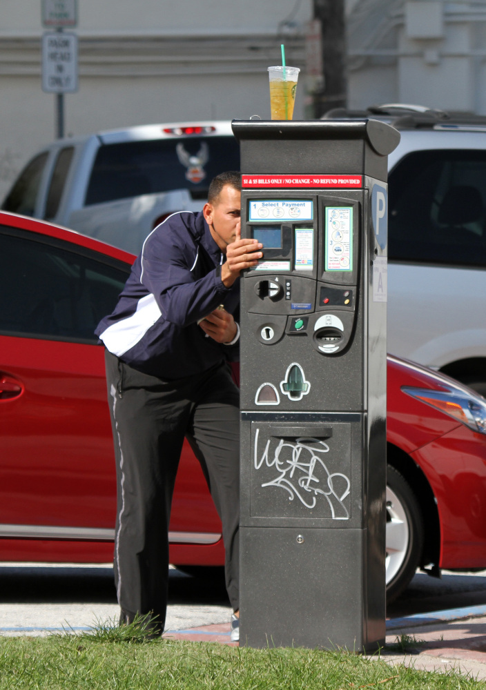 Alex Rodriguez is seen paying at the parking meter before entering a gym on in Miami Beach, Florida. When Rodriguez noticed a
