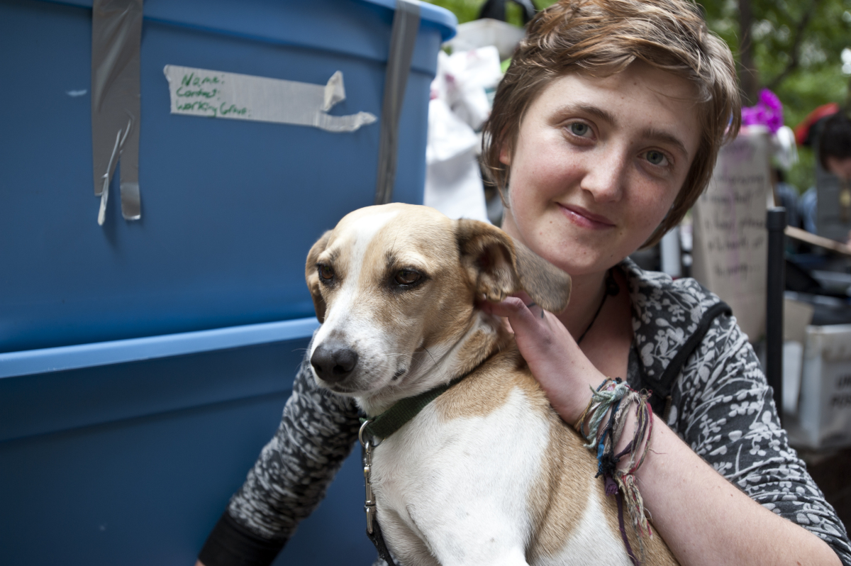 Jordan McCarthy and her dog, Calvin, attend the Occupy Wall Street protest in New York on Friday Oct. 14, 2011. (Damon Dahlen