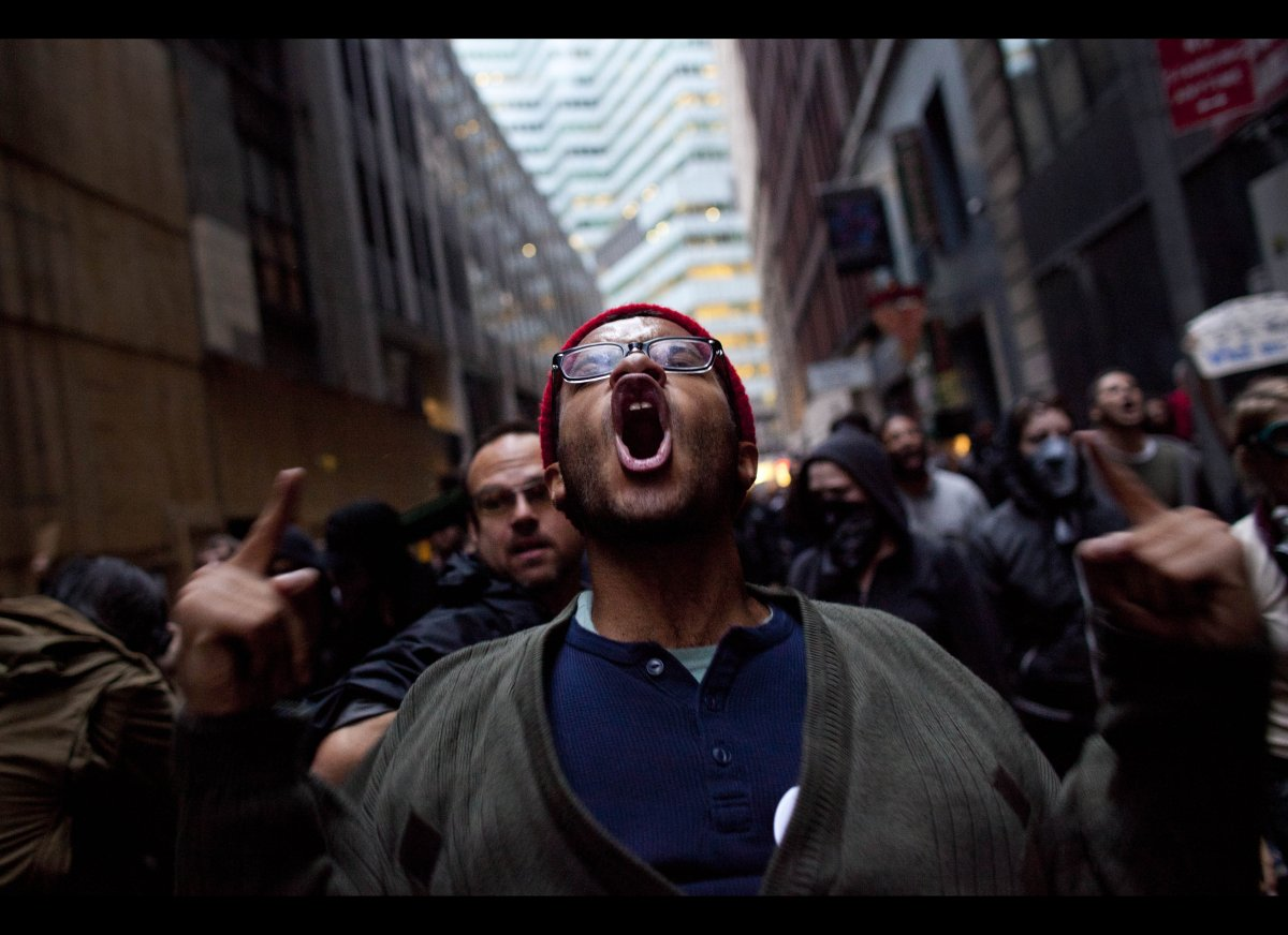 A protester participating in the Occupy Wall Street protests screams while marching towards Wall Street Friday, Oct. 14, 2011