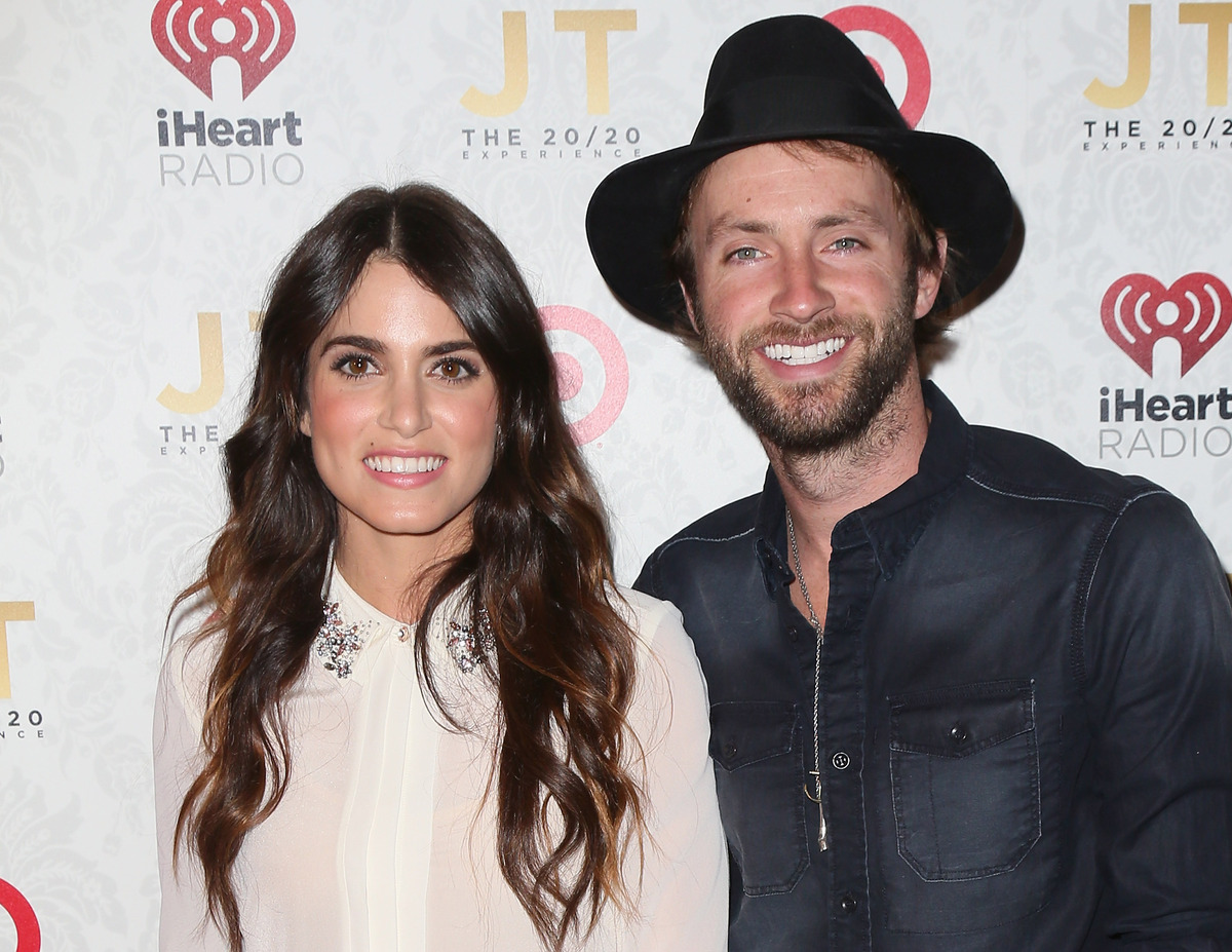 LOS ANGELES, CA - MARCH 18:  Actress Nikki Reed (L) and husband singer Paul McDonald attend the iHeartRadio '20/20' album rel
