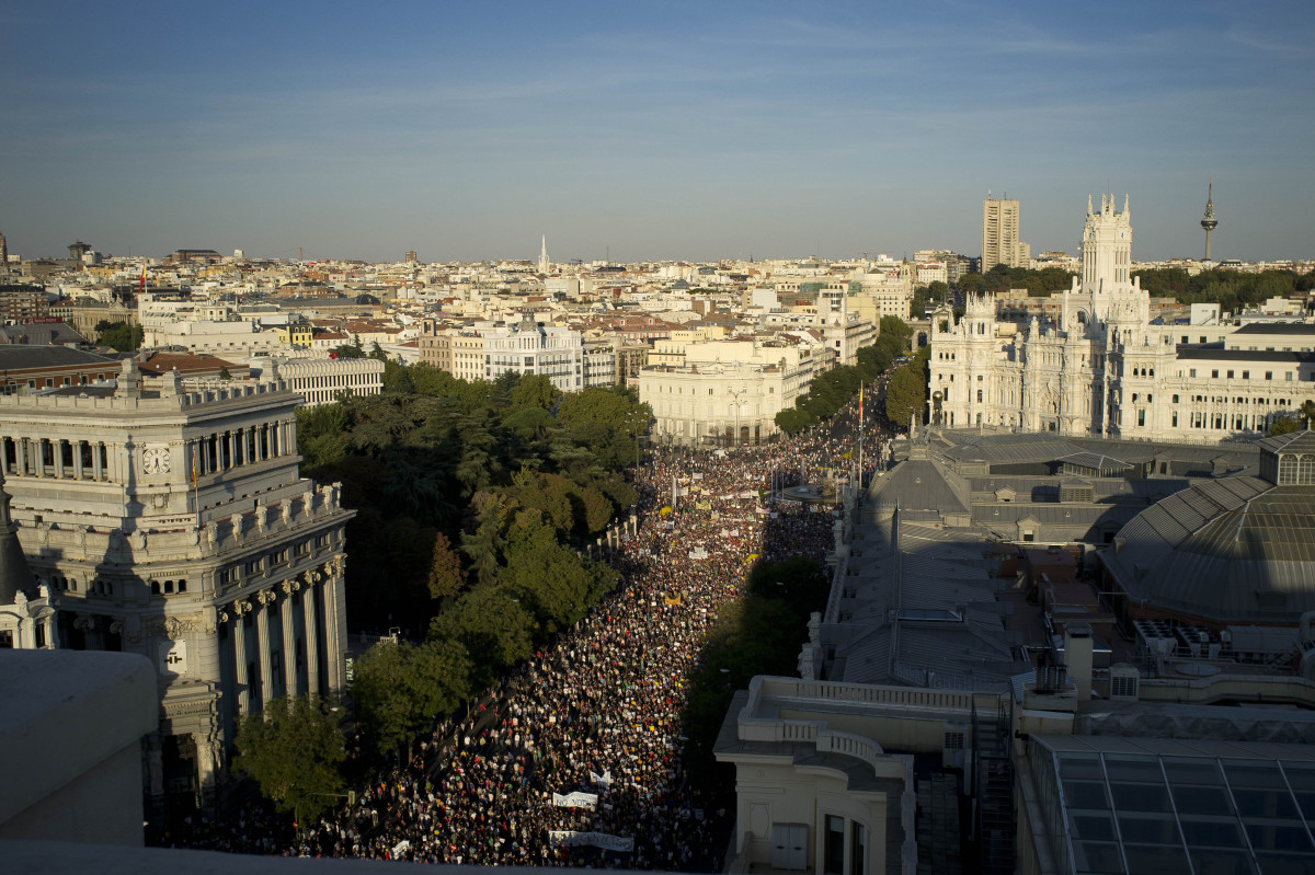 People take part in a demonstration as they march towards Puerta del Sol square in solidarity action for the worldwide protes
