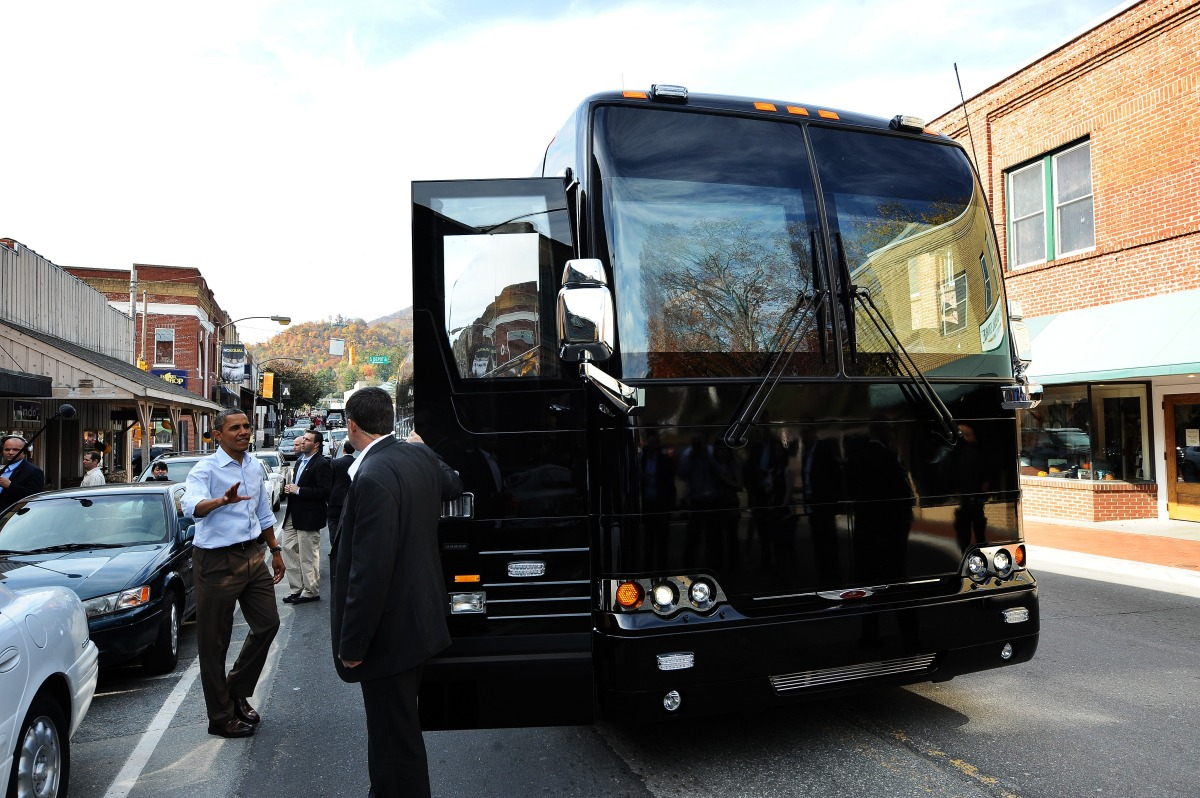 US President Barack Obama carries his lunch to his bus in Marion, North Carolina, on October 17, 2011 during the first day of