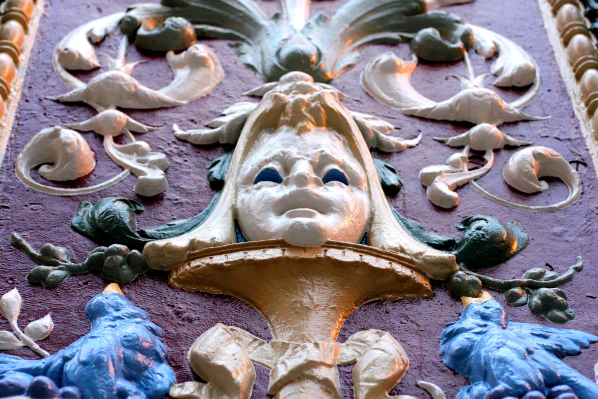 A close-up detail of some of the historic department store building's ornamentation.