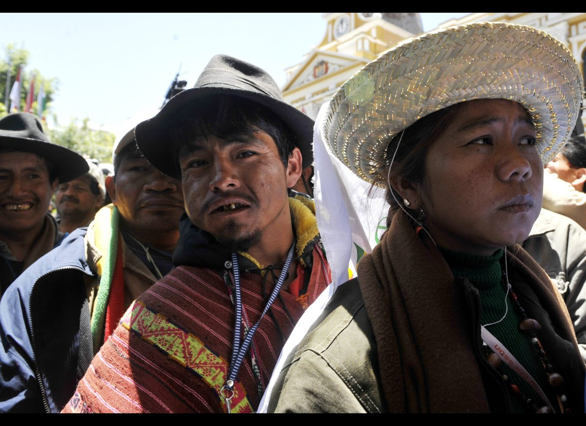 Amazonian natives arrive at the presidential palace to hold a meeting with President Evo Morales on October 21, 2011, as othe