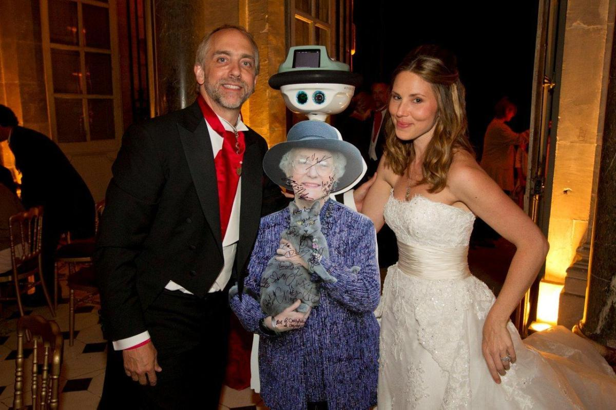 Richard Garriott's mother poses with the bride and groom at the Paris wedding in July 2011