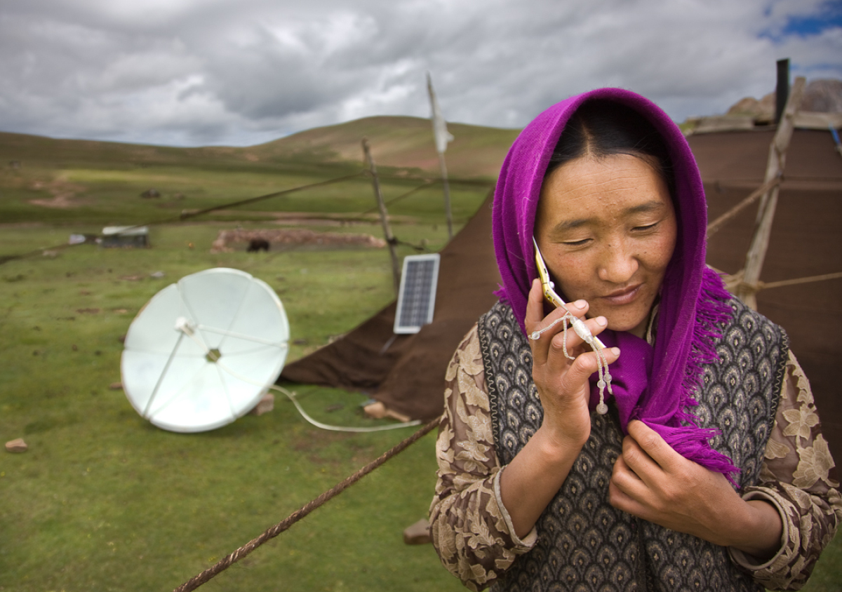 Droga, 37, and her 16-year-old daughter, who has never gone to school, take care of their yaks. Her cell phone costs $5 per m