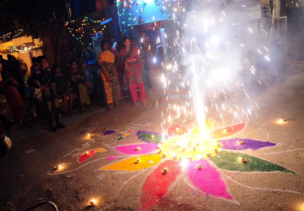 A Pakistani Hindu watches Diwali fireworks on October 26, 2011. Diwali, the festival of lights, is celebrated with jubilation