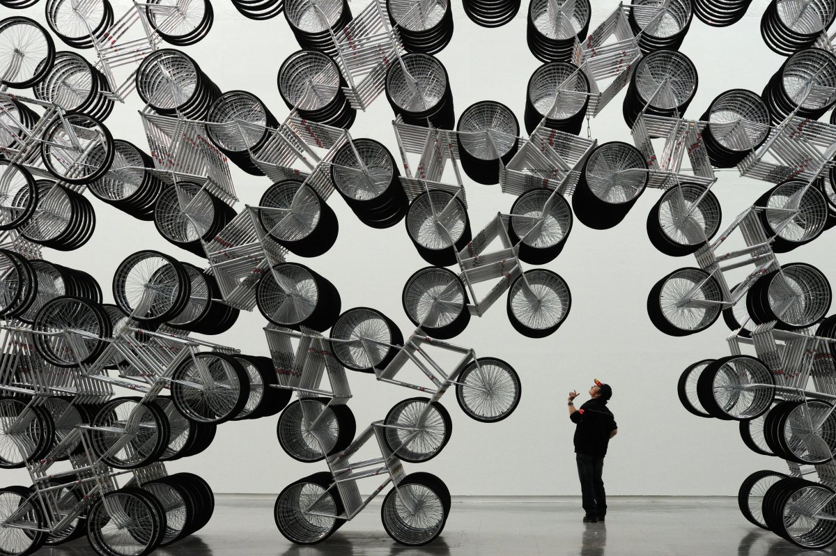A man admires an art work entitled 'Forever Bicycles' by Chinese dissident artist Ai Weiwei at the Taipei Fine Art Museum on