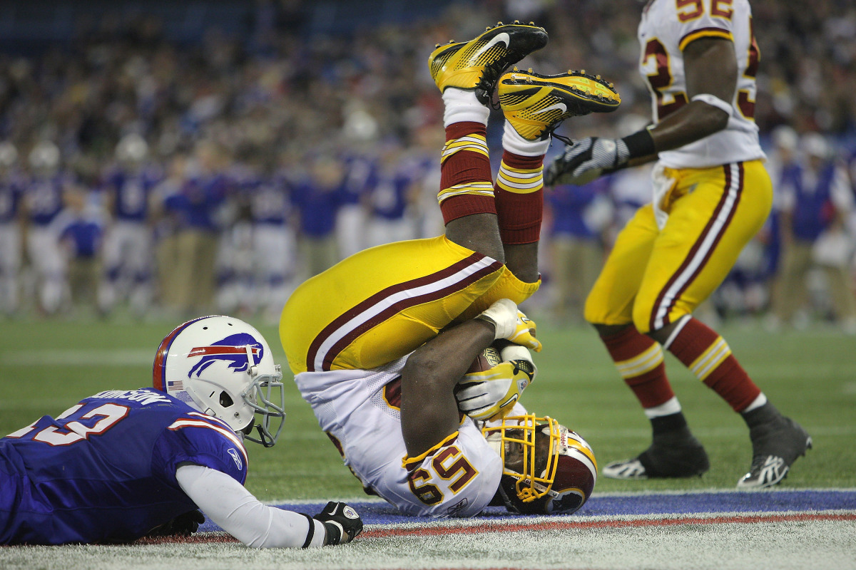 London Fletcher #59 of the Washington Redskins intercepts a pass in the end zone during NFL game action as Stevie Johnson #13