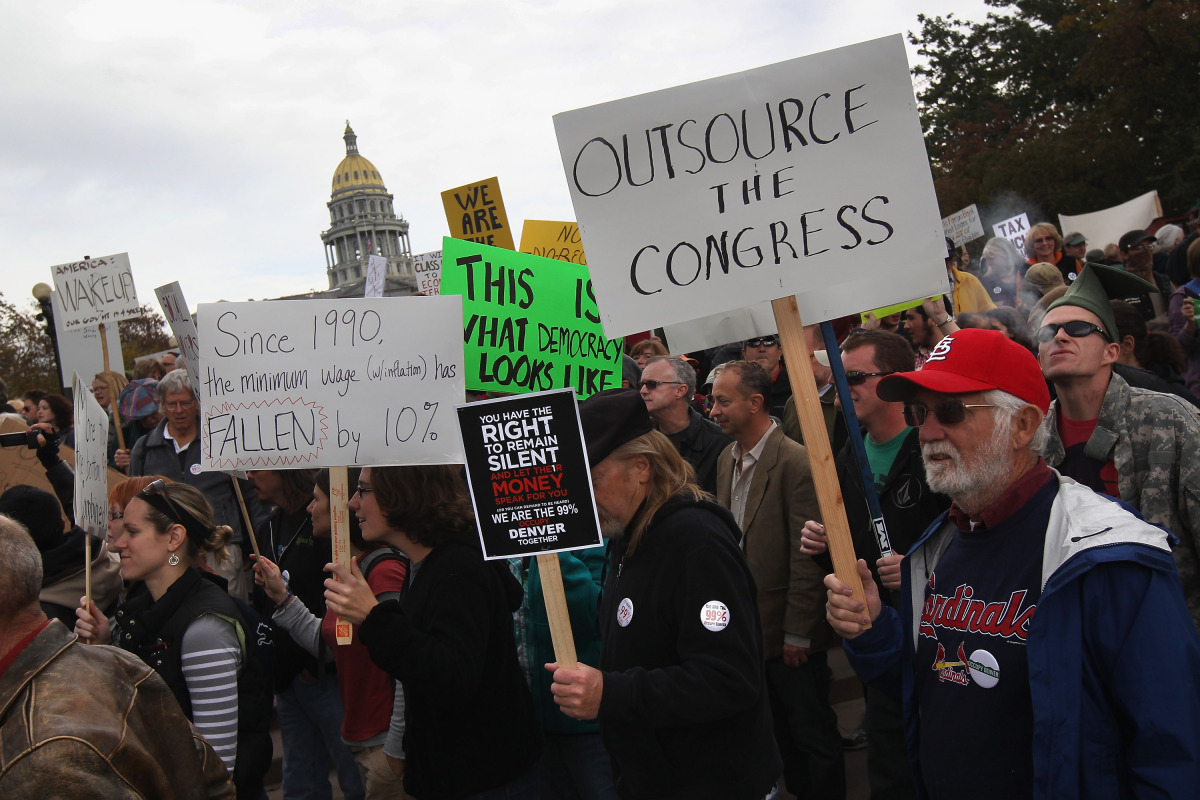 DENVER, CO - OCTOBER 29: Protesters walk past the Colorado state capital building during an 'Occupy Denver' march on October