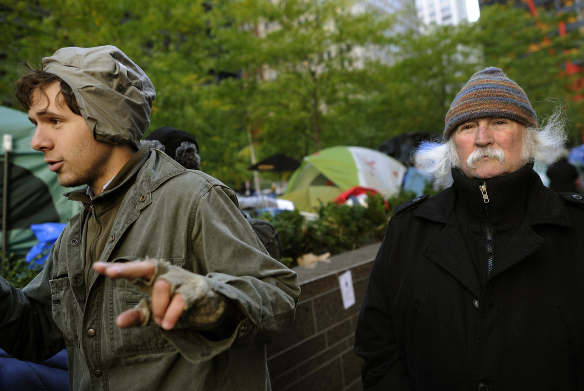 Singer David Crosby from Crosby, Stills and Nash (R) walks among the demonstrators with 'Occupy Wall Street' as they continue