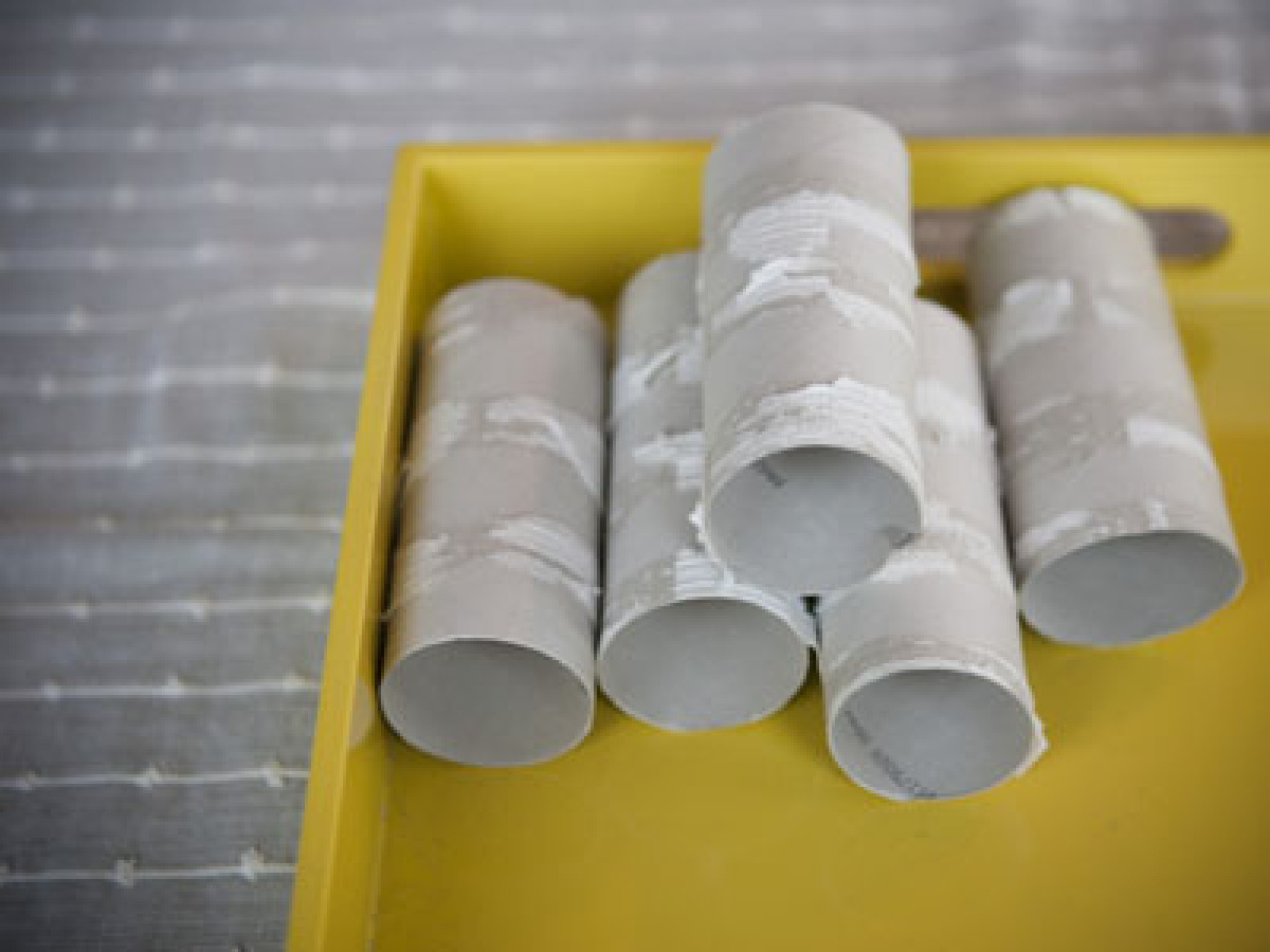 First, gather together cardboard toilet paper tubes and remove all the excess paper. If the paper is really sticking to the r