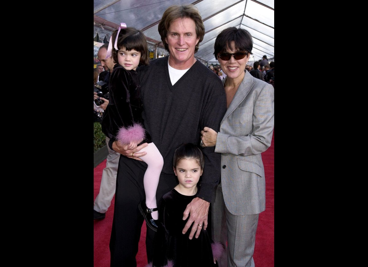 Former US gold medal decathlete Bruce Jenner (C), his wife Kris (R) and children Kylie (L) and Kendall (BELOW) appear at the,