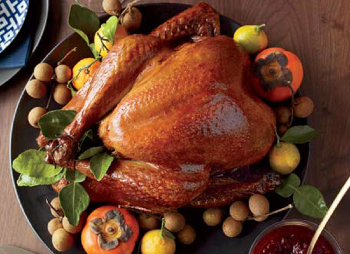 Here, turkey is marinated and basted with Asian ingredients like soy, sesame, honey and ginger, giving it superb flavor and a