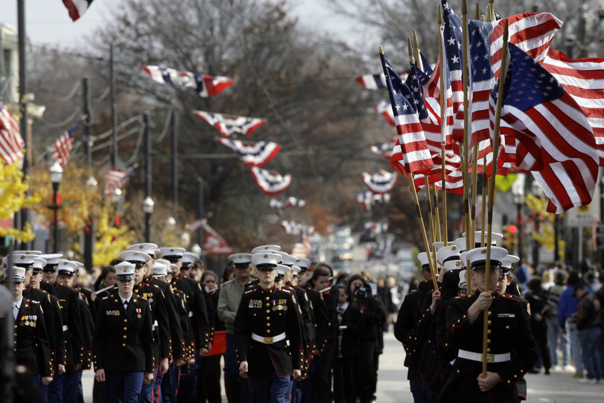 U.S. Marine Corps ROTC carry flags during a Veteran's Day parade Friday, Nov. 11, 2011 in Media, Pa.