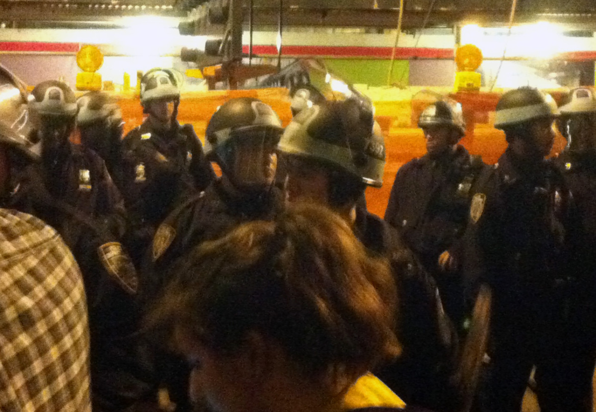 In this image made using a cell phone, police order Occupy Wall Street protesters to leave Zuccotti Park, their longtime en