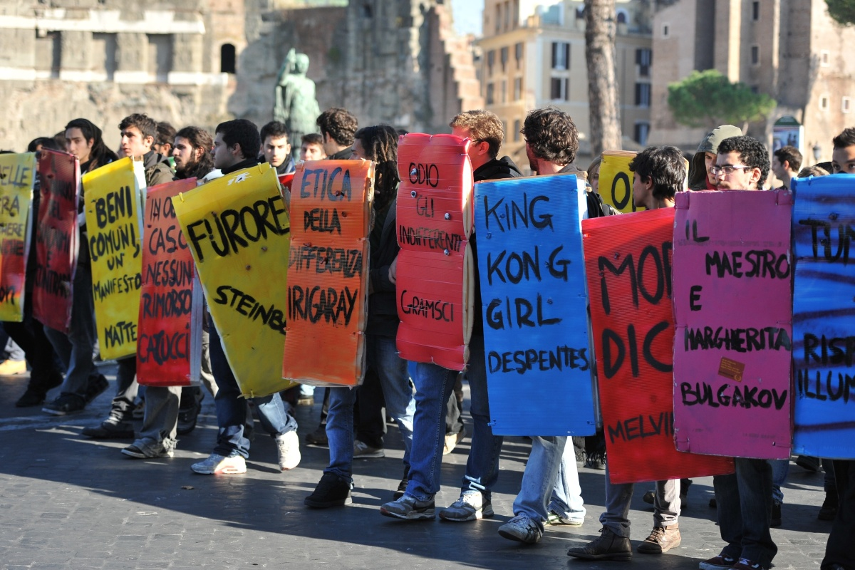 Students and protesters march at Piazza Venezia during a demonstration to protest against the cuts in the education budget an