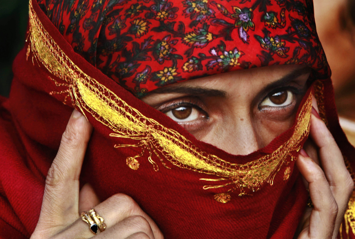 A Kashmiri Muslim government employee takes part in a protest rally in Srinagar, India, Tuesday, Nov. 15, 2011. Government em