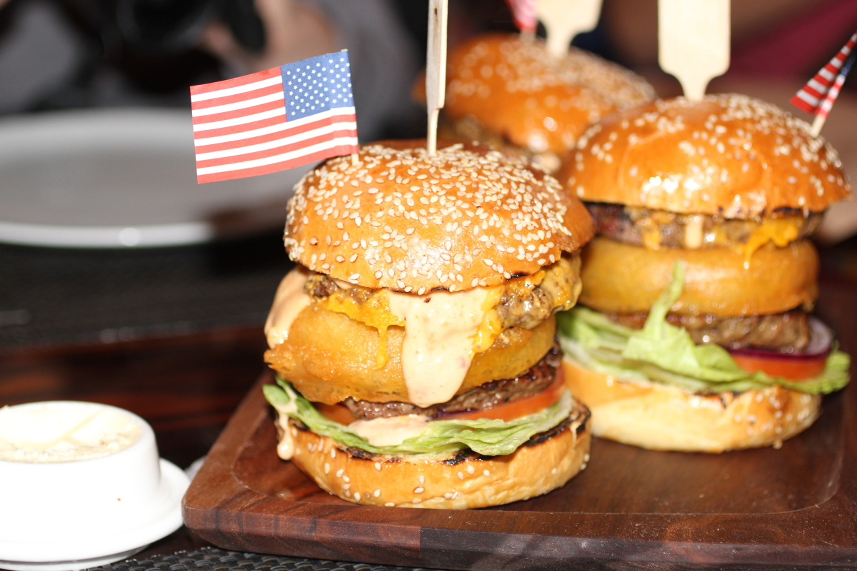 <strong>What's in it: </strong>Two double-stacked 4 oz. CAB burgers, an onion ring, bacon, lettuce, tomato, cheddar cheese an