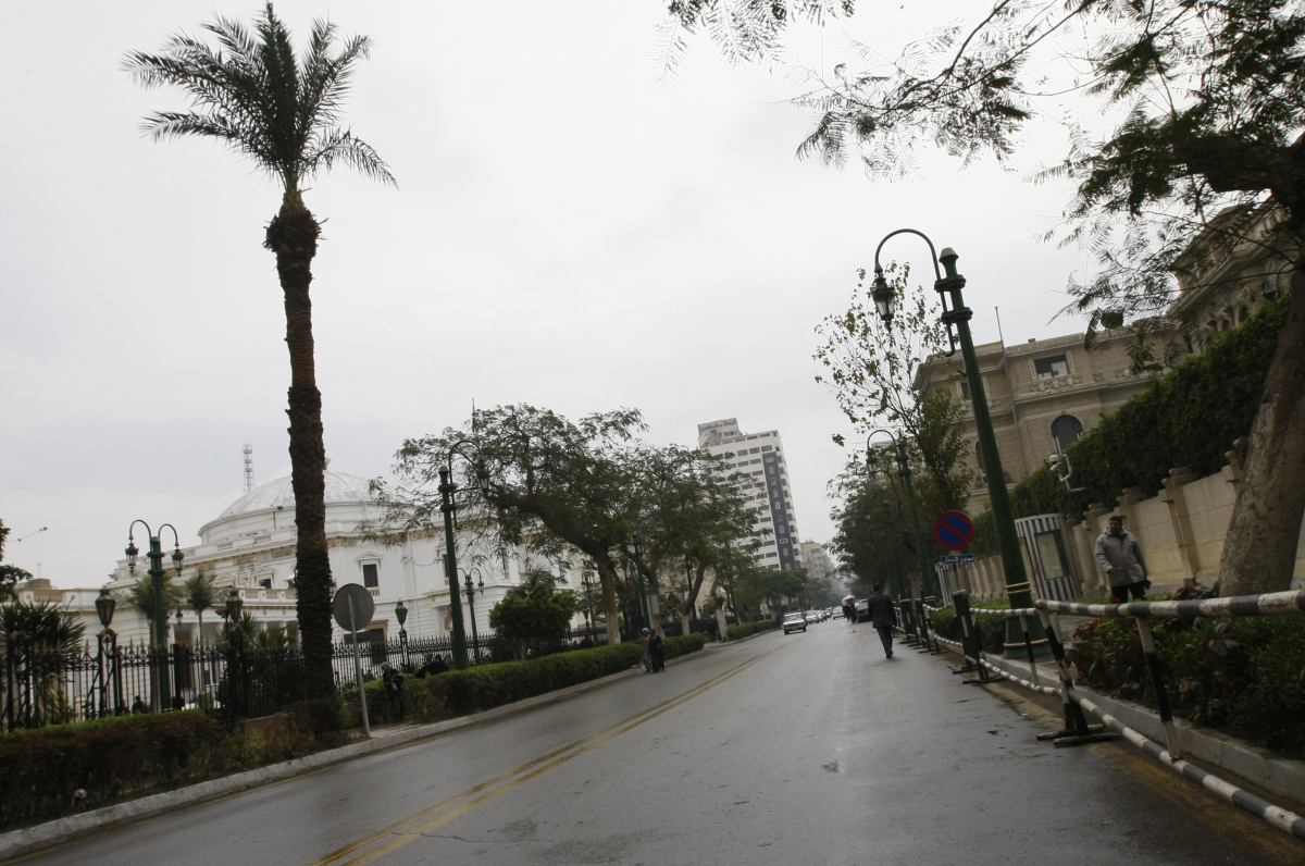 <em>A general view shows a deserted street in front of Egypt's parliament building in downtown Cairo where a man set himself