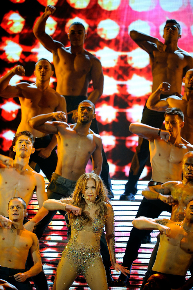 LOS ANGELES, CA - NOVEMBER 20:  Singer Jennifer Lopez (C) performs onstage at the 2011 American Music Awards held at Nokia Th