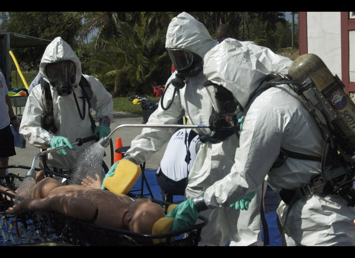 Emergency workers practice decontamination procedures during special tactical training for operations in hazardous environmen