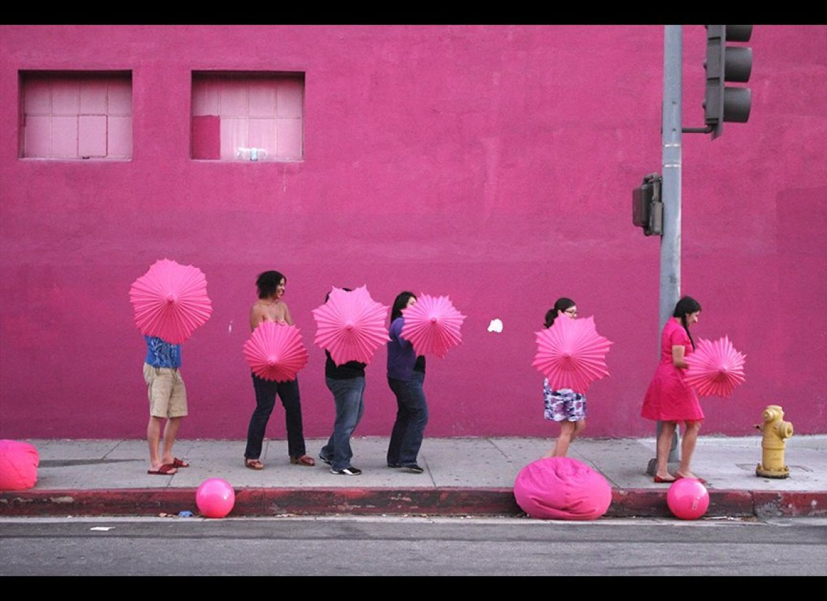 """Mary Younakof, Pink Parasols (Video still), 2011 Photographic print, 20"""" x 30"""", Edition of 7 Courtesy the artist"""