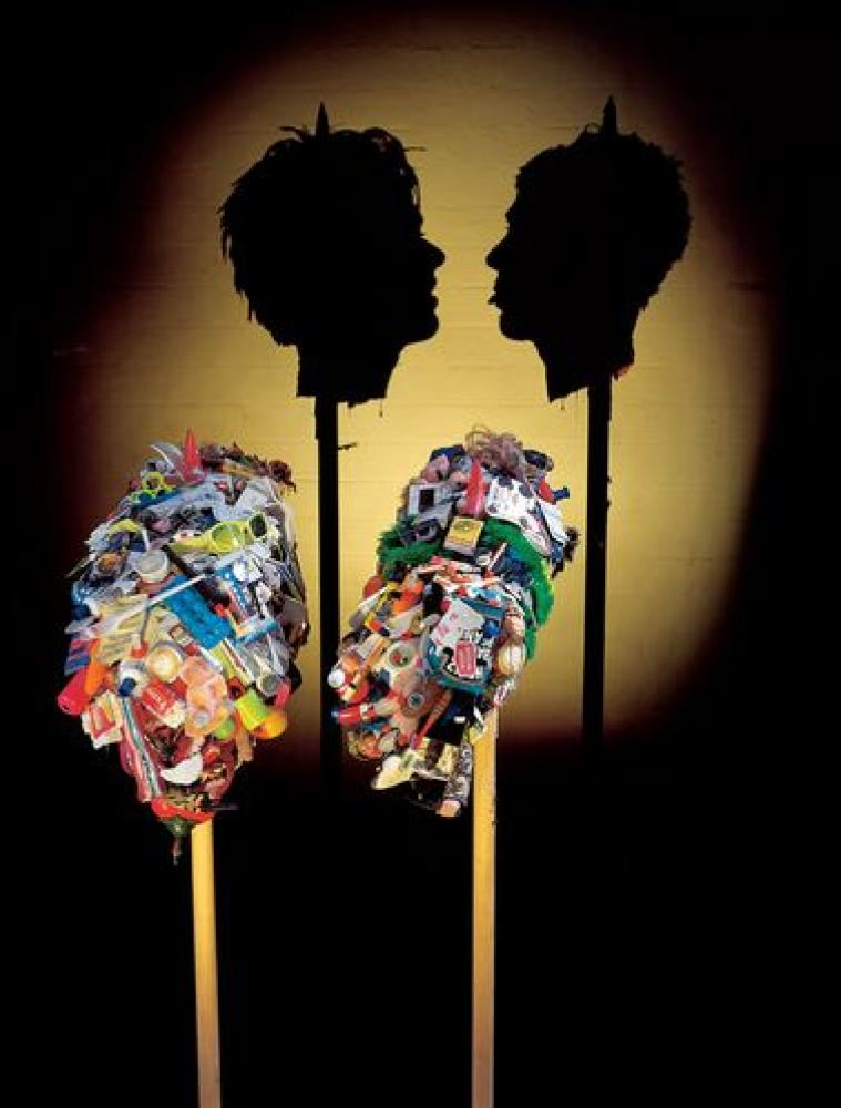 Miss Understood and Mr Meanor, 1997 (Trash and personal items, wood, light projector, light sensor)
