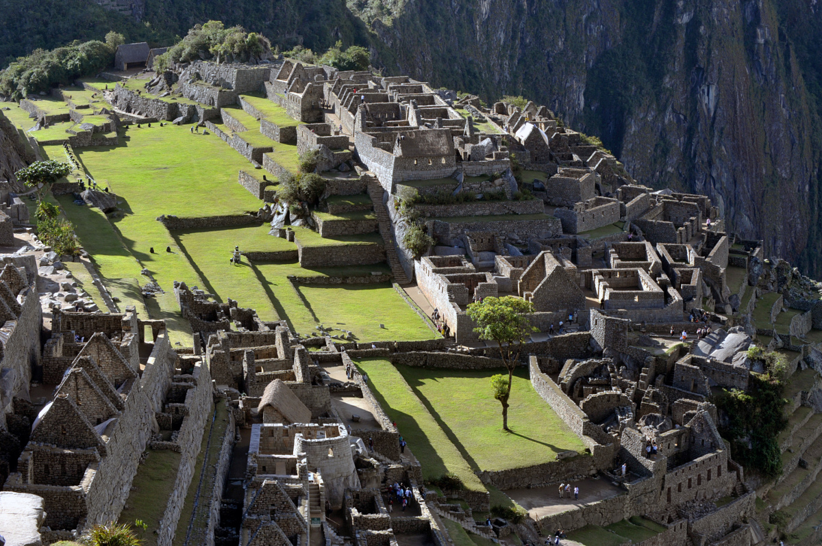 Tourists walk among the ruins of the Machu Picchu citadel, 130 km northwest of Cusco, Peru. CRIS BOURONCLE/AFP/Getty Images