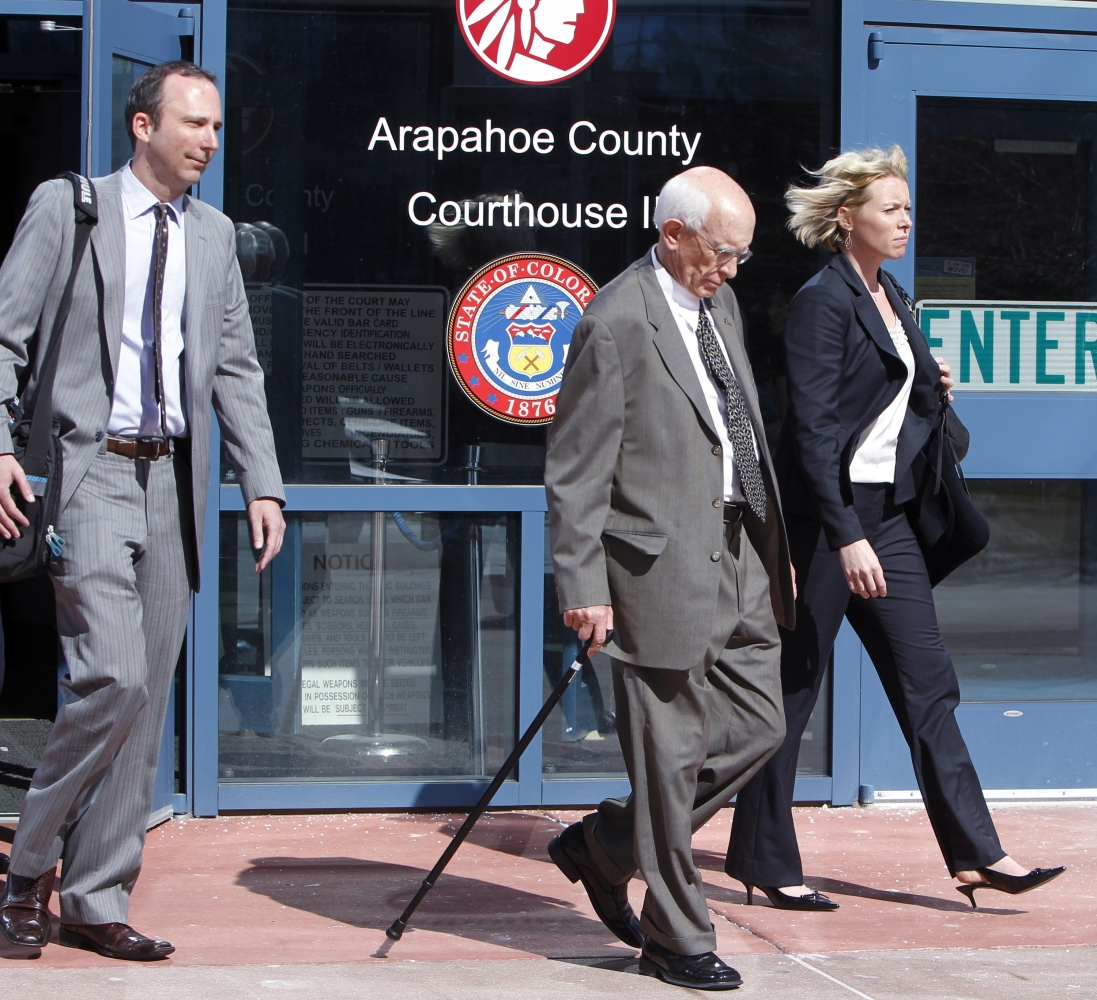 Former Arapahoe County Sheriff Patrick Sullivan, center, is flanked by attorneys Jessica Schmidt, right, and Kevin McGreevy a