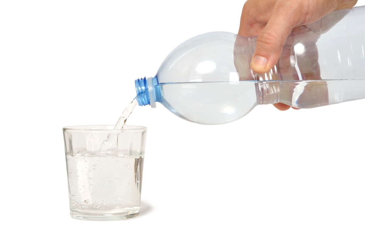 Buy it after the security checkpoint to take on board. Dehydration can cause or exacerbate hunger, jet lag and fatigue.