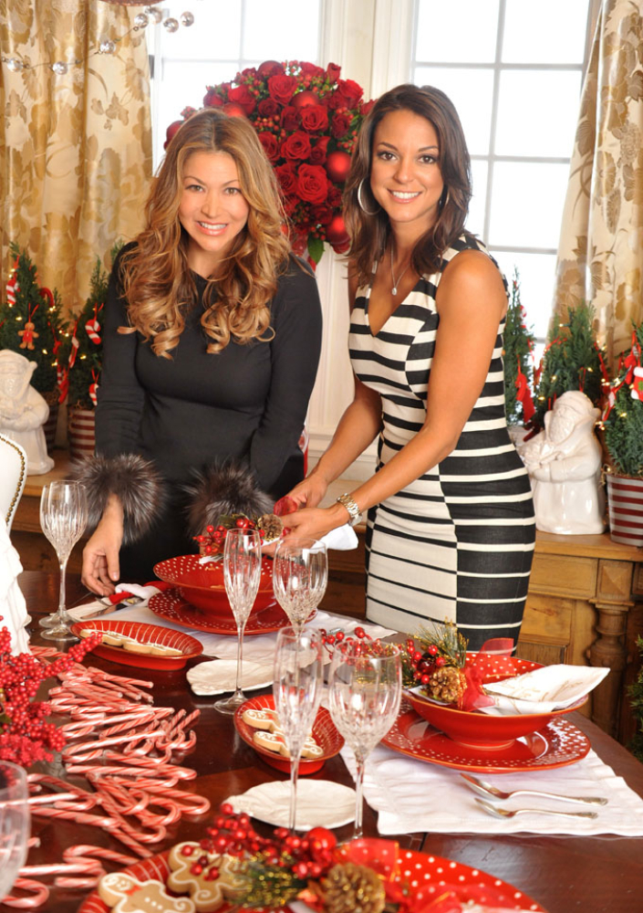 Designer Sandra Espinet and celebrity Eva LaRue add the finishing touches to the dining table.