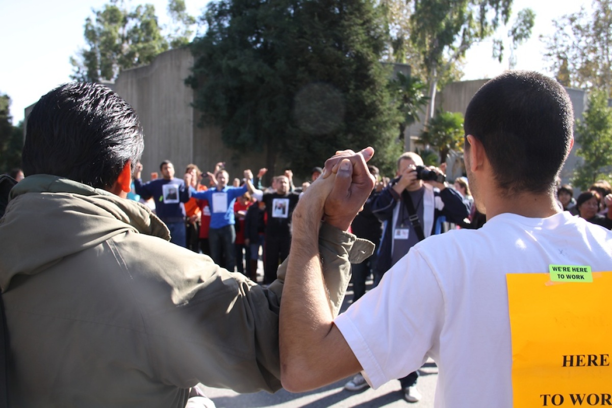Hundreds protest Pomona College's termination of undocumented workers; 17 arrests made.  Photo Credit: Aaran Patel