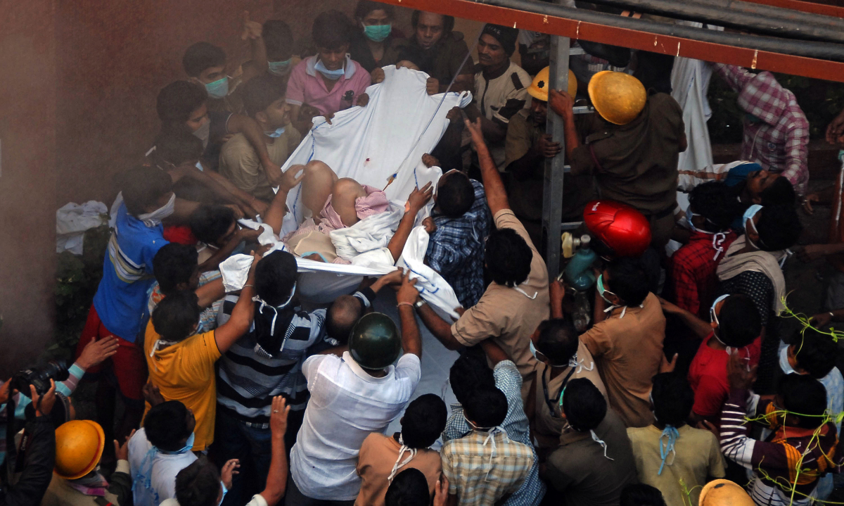 Rescue workers evacuate people after a fire engulfed a hospital in the eastern Indian city of Kolkata on Dec. 9, 2011. Nearly