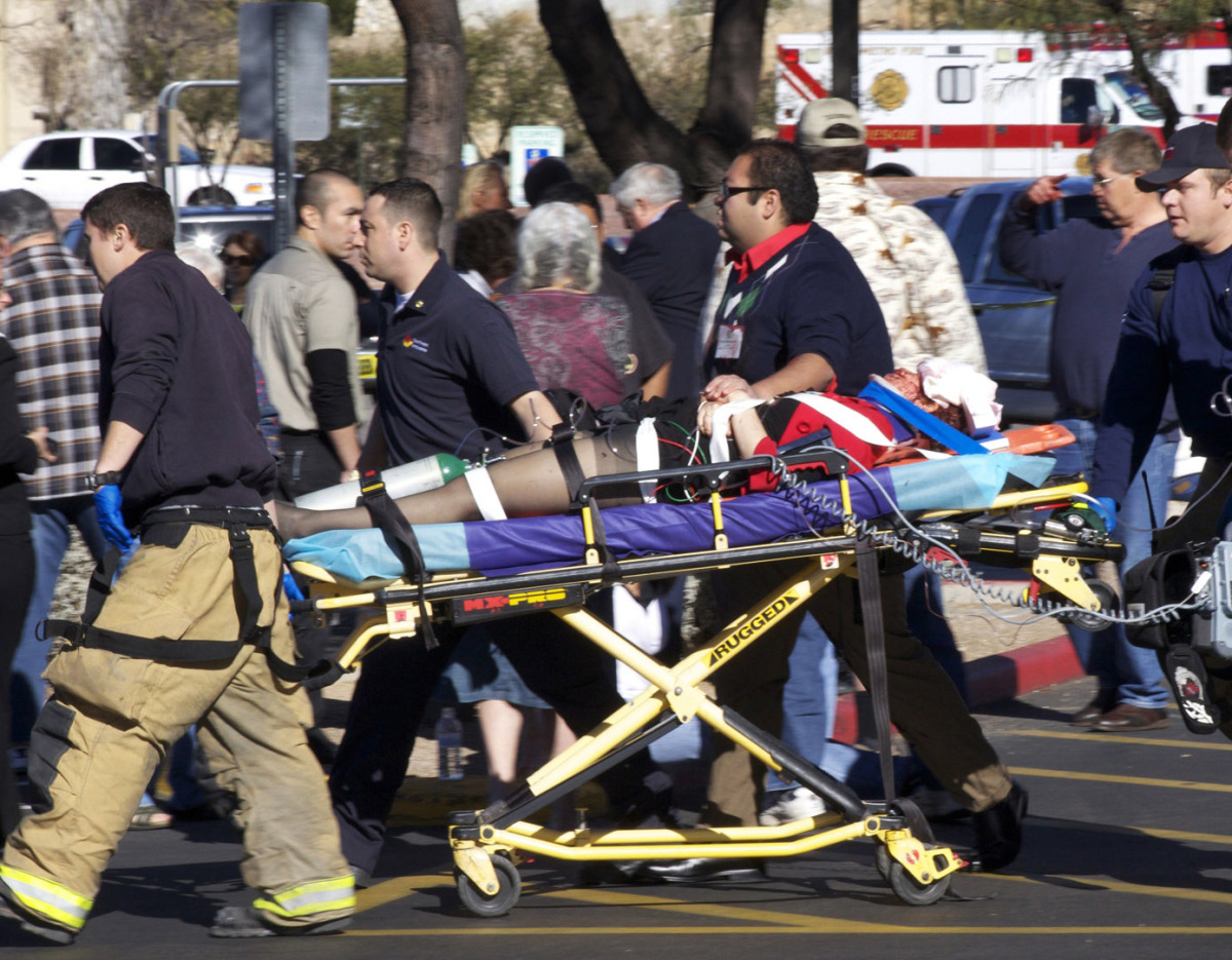 U.S. Rep. Gabrielle Giffords is wheeled away on a stretcher after being shot in the head in Arizona. Photographer James Palka