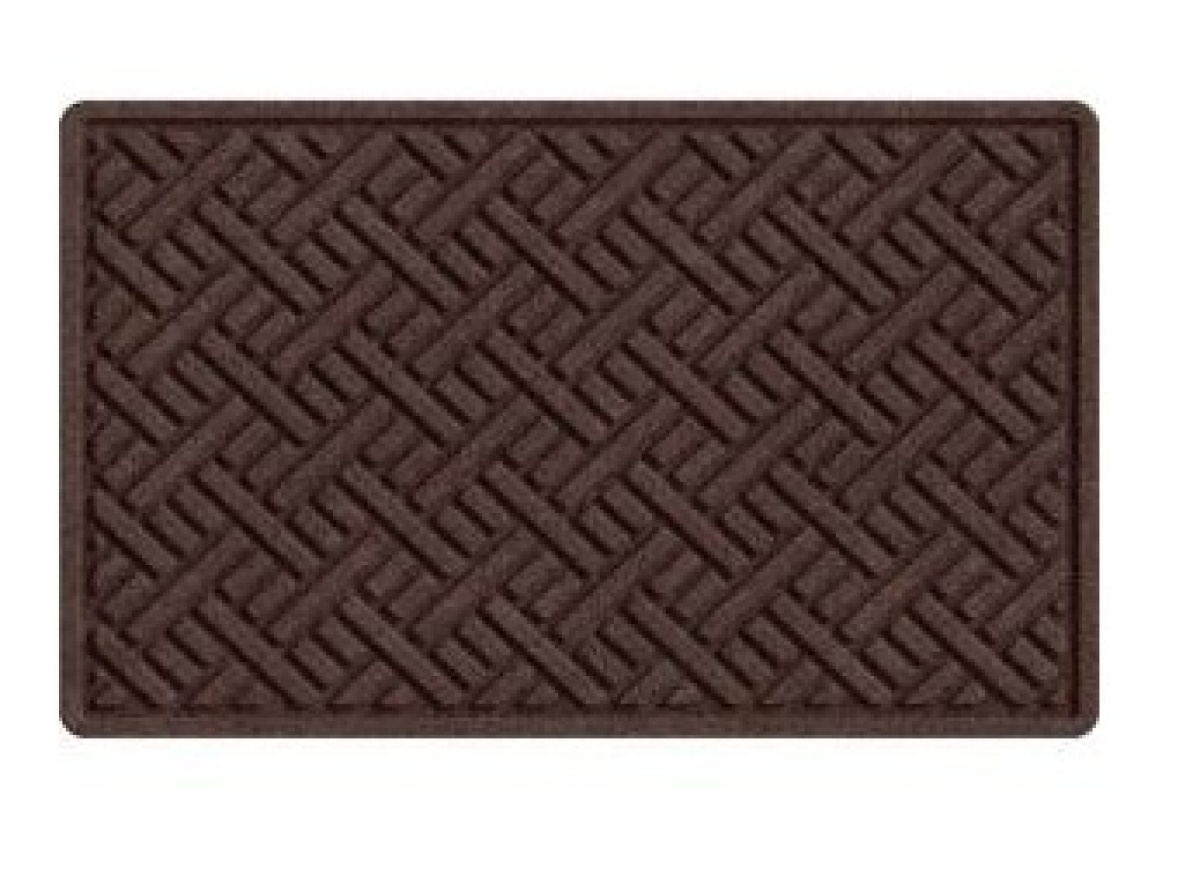 "This mat has a synthetic fiber surface and a textured rubber backing that keeps it in place. <a href=""http://www.homedepot.co"