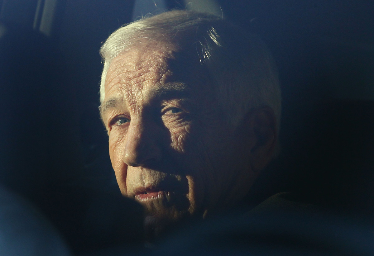 Former Penn State assistant football coach Jerry Sandusky sits in a car while leaving the Centre County Courthouse, on Dec. 1