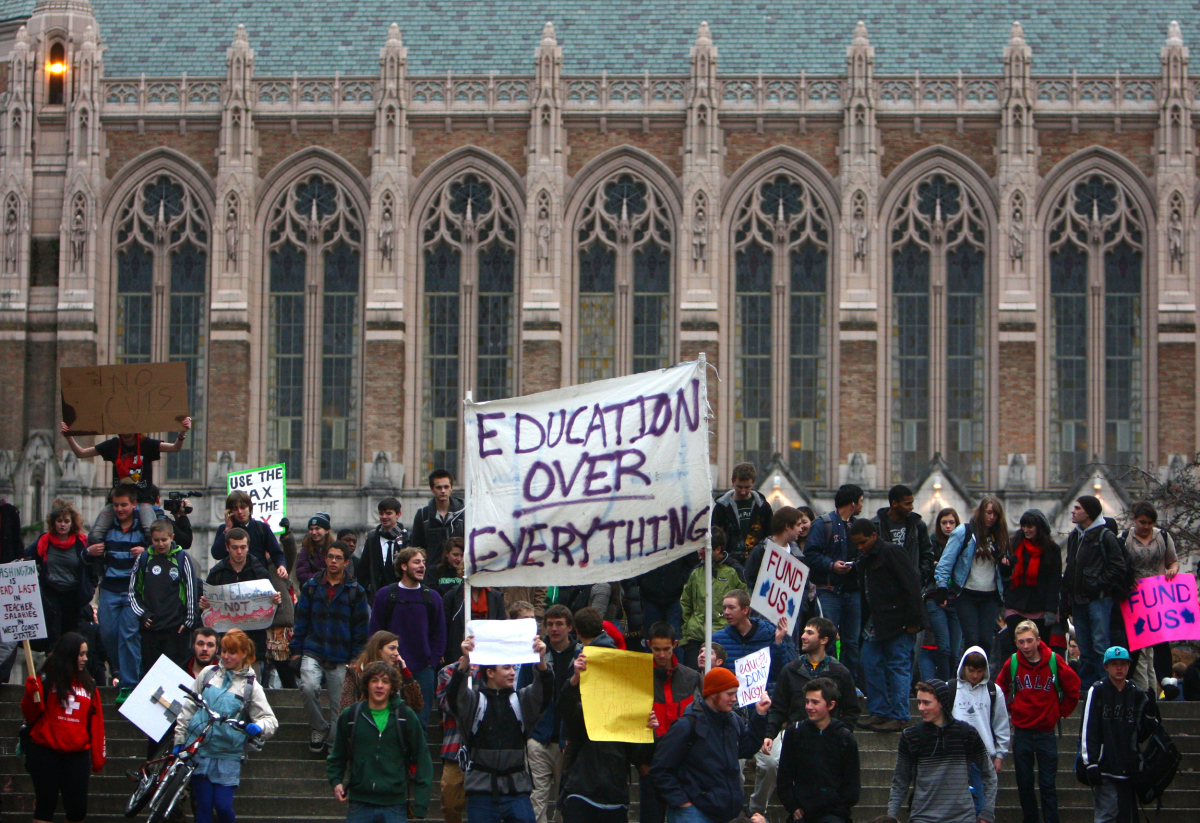 Hundreds of protesters march on the campus of the University of Washington during a walkout by Seattle area high school stude