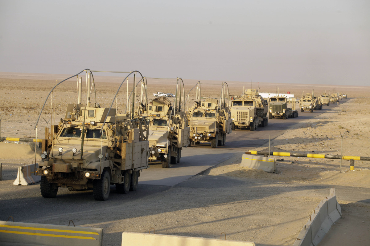 The last vehicles in a convoy of the U.S. Army's 3rd Brigade, 1st Cavalry Division crosses the border from Iraq into Kuwait,