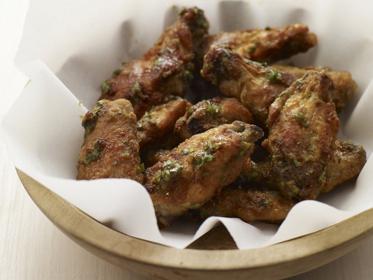 Everyday chicken wings take on an Asian flare with Thai green curry. A little bit spicy, and very much party worthy, these wi