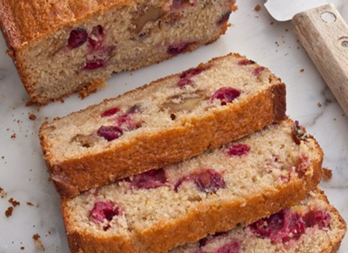 Sweet, orange-scented, and chock-full of cranberries and walnuts, this festive-looking bread is perfect for the holidays.